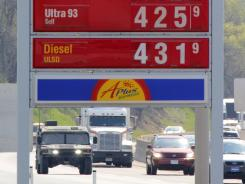 Gasoline prices at the Midway Plaza on the Pennsylvania Turnpike in Bedford, Pa., April 15, 2012. Consumer prices were flat last month as cheaper gas offset modest increases for food, clothing and housing.