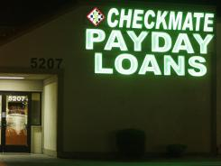 A neon signs illuminates a payday loan business in Phoenix. A recent survey suggests many underbanked millennials are turning to alternative financial services.
