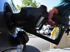 A driver pumps gas into her car in Los Angeles.
