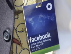 Facebook spokesman Larry Yu displays a credential for a Facebook IPO roadshow event in Palo Alto, Calif.