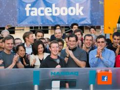 Facebook founder, Chairman and CEO Mark Zuckerberg, with microphone, rings the opening bell of the Nasdaq stock market, Friday, May 18, 2012, from Facebook headquarters in Menlo Park, Calif.