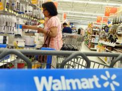 Shoppers look at merchandise at Walmart in Danvers, Mass.
