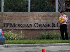 Security officers stand guard at the building where a JP Morgan Chase shareholders meeting was taking place on May 15, 2012 in Tampa, Fla.