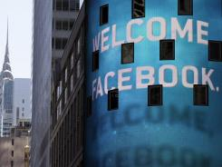 The animated facade of the Nasdaq MarketSite welcomes Facebook's IPO in New York's Times Square.
