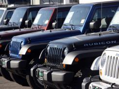 A lineup of 2010 Jeep Wranglers at a Chrysler/Jeep dealership in Englewood, Colo., on Nov. 1, 2009.