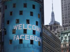 The animated facade of the Nasdaq MarketSite announces the Facebook IPO in New York's Times Square on Friday.
