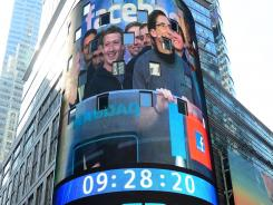 Facebook co-founder Mark Zukerberg is seen on a screen in Times Square in New York as he is getting ready to ring the NASDAQ stock exchange opening bell.
