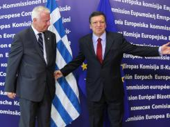 European Commission President Jose Manuel Barroso, right, and Greek Prime Minister Panagiotis Pikrammenos at commission headquarters in Brussels on Wednesday.