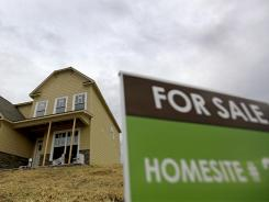 A new home for sale stands under construction in a development Friday, March 23, 2012, in Atlanta. Sales of U.S. new homes fell in February for the second straight month, a reminder that the depressed housing market remains weak despite some improvement. (AP Photo/David Goldman)
