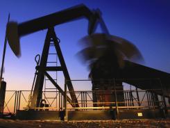 An oil pump working in the Persian Gulf desert field of Sakhir, Bahrain.