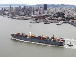 East Coast ports are preparing to handle ships like the MSC Fabiola, here passing the San Francisco waterfront. The container ship, almost a quarter-mile long, is the largest to dock at any port in North America.