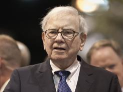 Warren Buffett, chairman and CEO of Berkshire Hathaway, participating in a newspaper throwing competition prior to the Berkshire Hathaway shareholders meeting in Omaha, Neb., on May 5, 2012.