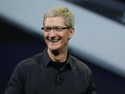 Apple CEO Tim Cook announces the new iPad in San Francisco in March 2012.