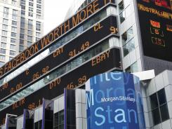 A financial news stock ticker on Morgan Stanley headquarters carries a headline about Facebook on May 23, 2012, in New York.