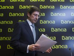 Bankia's president Jose Ignacio Goirigolzarri arrives for a press conference at the bank's headquarters Saturday in Madrid.