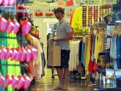 A shopper April 24 at an American Apparel store in Santa Monica, Calif.
