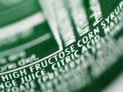 soft-drink can with high-fructose corn syrup listed as an ingredient.