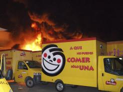 Flames rise from a warehouse of Mexican potato chipmaker Sabritas, a PepsiCo unit, in Lazaro Cardenas, Mexico late May 25, 2012.