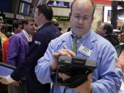 On May 30, 2012, trader Peter Mancuso works on the floor of the New York Stock Exchange.