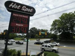 A sign for $2.99 a gallon gasoline at a convenience store Friday in Spartanburg, S.C.