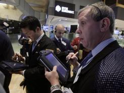 Richard Cohen, right, works with fellow traders on the floor of the New York Stock Exchange on May 30, 2012.