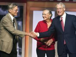 From left, Jim, Alice and Robson Walton, at the beginning of the Wal-Mart Stores' shareholders meeting on Friday in Fayetteville, Ark.