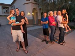 The Jacobsons, left -- Jodi, Steve and Grace, 5 -- are friends with the the Pierces -- parents Jessica and Mark with Tanner, 13, Chloe, 5, and Carly, 3. Both families lost their homes to foreclosure and now rent in the same Gilbert, Ariz., subdivision.