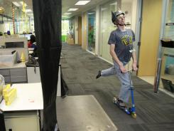 Paul Walker of Zappos.com demonstrates his preferred method of travel at company offices in Henderson, Nev., outside Las Vegas.