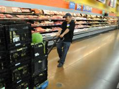 Manny Demillo moves a pallet inside a Walmart in Rosemead, Calif.