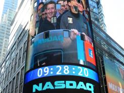 Facebook co-founder Mark Zukerberg is seen on a screen getting ready to ring the Nasdaq stock exchange opening bell in Times Square in New York, May 18, 2012.
