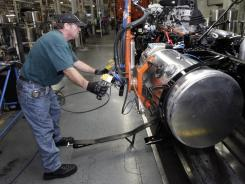 Thomas Warren installs a fuel cell on a Freightliner truck at a plant in Cleveland, N.C. in January.