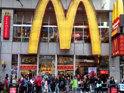 People walk around a McDonald's restaurant in New York's Time Square on May 6, 2012.
