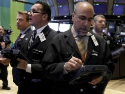 Traders work on the floor of the New York Stock Exchange on June 7, 2012.