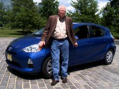 James R. Healey with the Toyota Prius c hybrid.