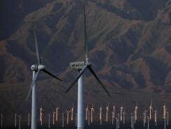 China topped the U.S. in renewable energy investment last year with $52 billion. Windmills operate at the Da Bancheng Wind Farm in Xinjiang, China, in this file photo.