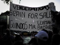 A protest Monday against Spain's financial support of the European Union in front of a Bank of Spain building in Barcelona.