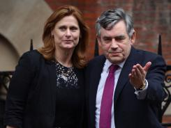 Former British prime minister Gordon Brown arrives with wife Sarah to testify Monday to the inquiry into media ethics in London.