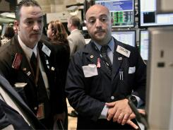 Traders work on the floor of the New York Stock Exchange in June 2012.