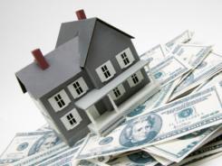 Sliding home values have knocked down median net worth.