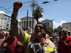 In Greece: Firefighters  protest in Athens on May 30. The embattled country's future in the eurozone is in question.