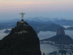 The Christ the Redeemer statue with Sugar Loaf mountain in the background in Rio de Janeiro.