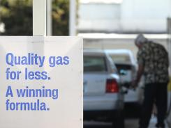 A customer pumps gasoline June 12, 2012 in Mill Valley, Calif.