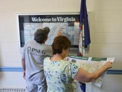 Travelers look at maps at a Welcome Center and rest area on Virginia's Interstate 66 in this file photo.