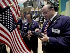 Traders work on the floor of the New York Stock Exchange in June 2012.