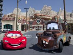 Cars characters Lightning McQueen, left, and Mater at California Adventure's new 12-acre Cars Land, which is a replica of the town Radiator Springs in the Disney-Pixar movies.