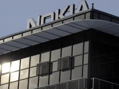 Nokia offices in Salo, Finland. Nokia Corp. will lay off 10,000 jobs globally and close plants by the end of 2013, the company said Thursday.