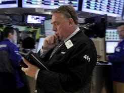Trader Michael Iervoline works on the floor of the New York Stock Exchange in June 2012.