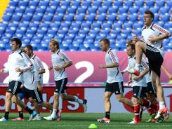 Danish forward Niklas Bendtner, right, and teammates attend a training session at the Metalist stadium in Kharkiv, on June 8, 2012 during the Euro 2012 football championships.