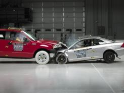 A pickup truck and car collide during crash testing conducted by the Insurance Institute for Highway Safety.