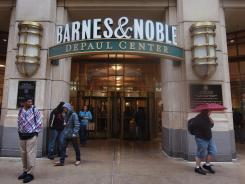 People walk by a Barnes & Noble store in Chicago.